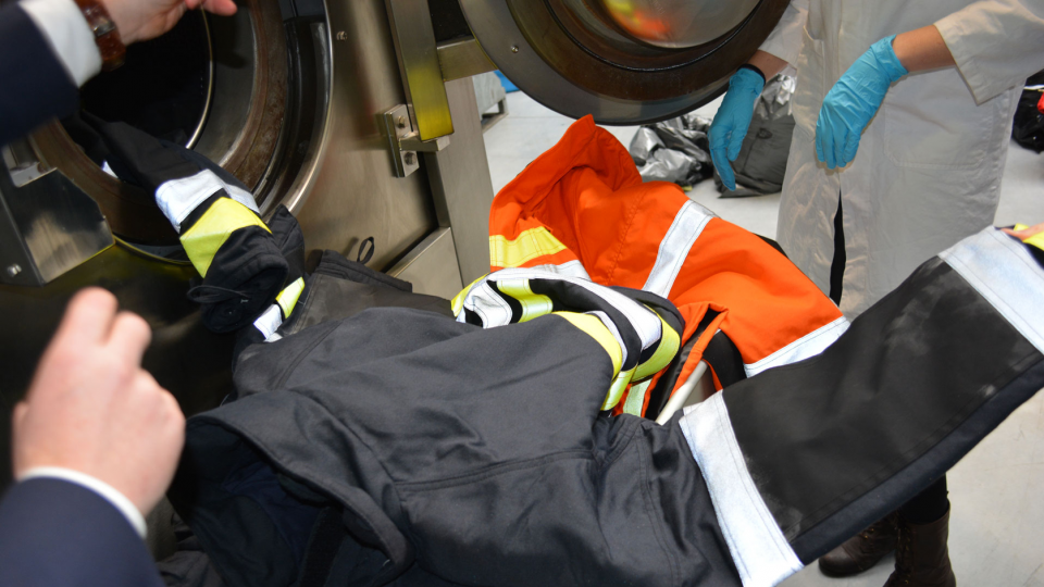 Decontex, a CTIF Associate Member company demonstrating their advanced washing machine for turnout gear.