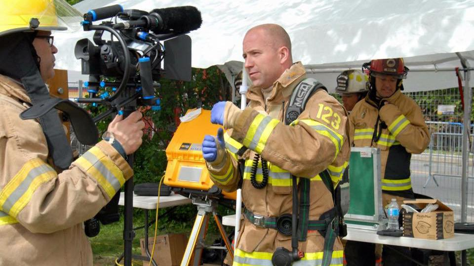 A firefighter being interviewed by another firefighter