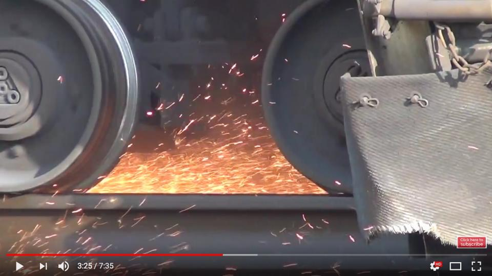 Train creating sparks as the metal wheels grind against the rails. Screen dump from a video by Wide World of Trains.